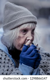 No home. Sad poor woman being outside in winter while having no home