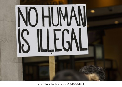 No Human is illegal protest banner at a political march