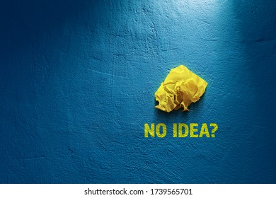 No idea, creativity improvement concept. Crumpled paper and question no idea? Creative company has solution - advertisement concept.