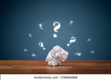 No idea, creativity improvement concept. Crumpled paper and question marks. Creative company has solution - advertisement concept.