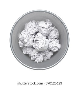 No idea - top view, Crumpled paper can recycle was thrown to metal basket bin. Overflowing waste paper in office garbage bin. Junk, wastepaper in rubbish isolated on white background with clip path