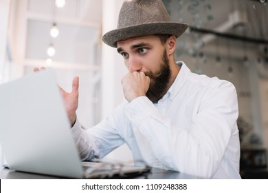No ideas. Virus detection, spam, blackmail. Frustrated and tired man using laptop computer, deadline.