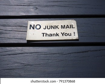 No junk mail metallic sign in a wood deck