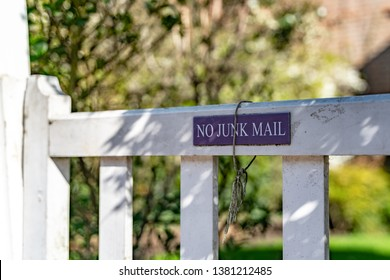 No Junk Mail sign on the the garden gate of a typical English residential old London town house