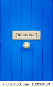 A No Junk Mail sign on a wooden door outside in Dublin, Ireland.