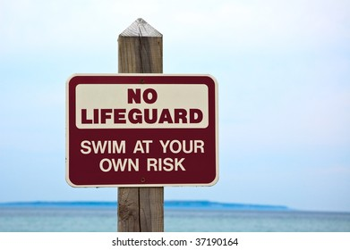 """No lifeguard. Swim at your own risk"" sign."