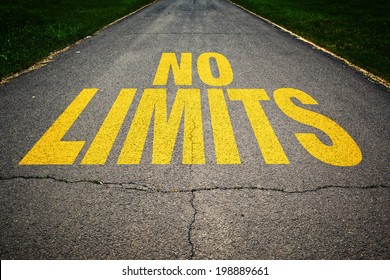 No Limits message on asphalt road. Concept of safe driving, road safety and preventing traffic accident.