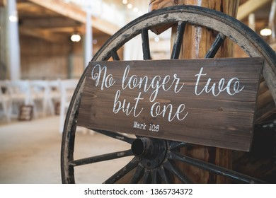 No longer two but one sign against wagon wheel