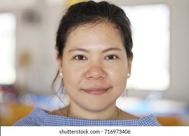 No make up smilingly beautiful asian woman