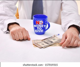 No Money To Give Tea Cup Money Politician Hands Government Shutdown. The O in No has American Flag Stripes