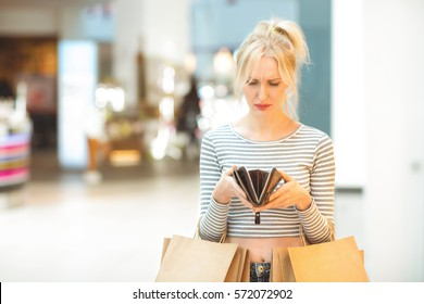 No money left. Mature disappointed woman looking into her empty wallet after shopping too much poor shopaholic money credit loan upset sad depressed empty cash unhappy overspending concept copyspace