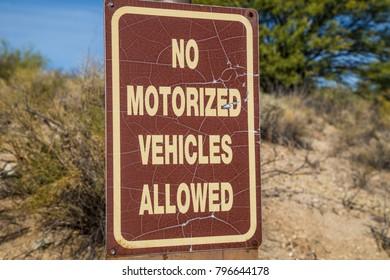 No Motorized Vehicles Desert sign wilderness signage yield stop hazardous brown