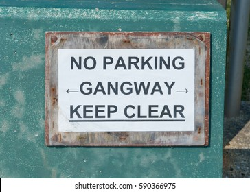 """""""No Parking, Gangway, Keep Clear"""" Sign in the Seaside Village of Branscombe on the Jurassic Coast of Devon, England, UK"""