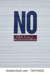 No parking hand painted sign