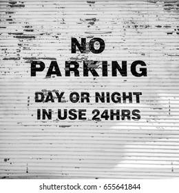 No parking sign in bold letters on garage door