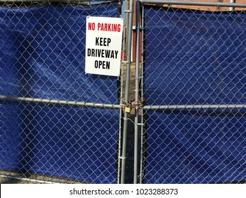 No Parking Sign, Keep Driveway Open, on blue tarp background