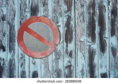 no parking sign on grungy garage door background