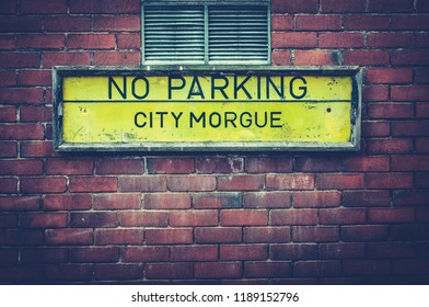 A No Parking Sign Outside A City Morgue In A US City