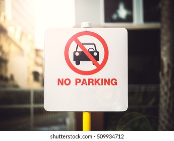 No Parking Sign in sunlight background
