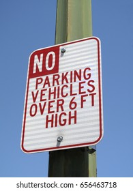 No parking sign for vehicles over six feet high