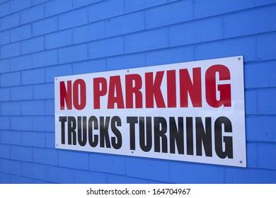 No Parking Trucks Turning Sign