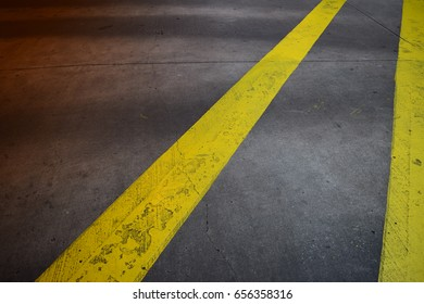 No passing zone. Black top with yellow no crossing lines.