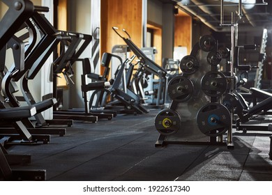 No people photo of a room equipped with gym machines for exercising and bodybuilding