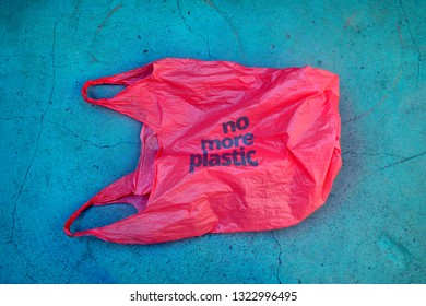 No plastic. Environmental awareness vindication shot. It shows a red plastic bag garbage with motto no more plastic.