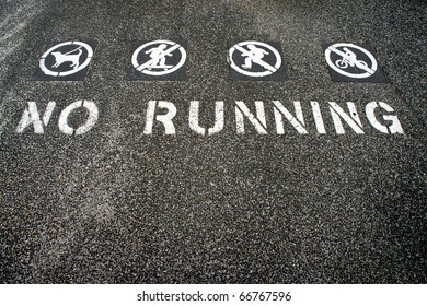 no running sign painted on the ground