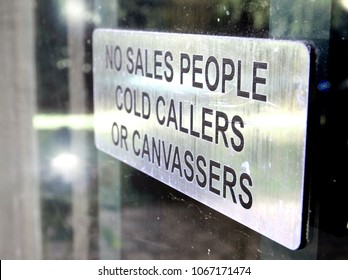 No sales people, cold callers or canvasser silver sign on glass door