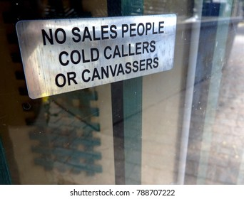 No salespeople cold callers or canvassers sing on a glass door