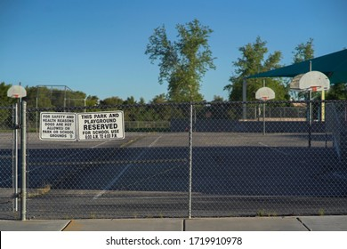 No School Warning Signs On A Basketball Court Fence