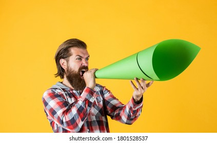 No secrets. hipster screaming in the megaphone Activist speaks at rally. Make it heard. oratory and rhetoric. mature crazy mad man pose with megaphone. announcement concept. stop being silent.