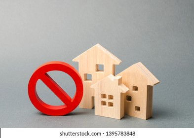 No Sign and the wooden house on an gray background. Inaccessible and expensive housing. Seizure and freezing of assets by a bank, court. Selective focus Unavailability of housing, busy or low supply.