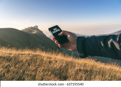 No signal cellphone network,No communication coverage,lost contact signal device,Hand holding smart phone searching signal,Selective focus and vintage tone.