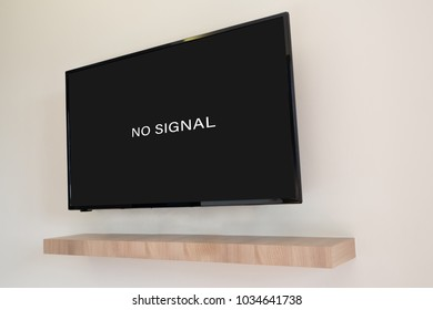 No signal sign on Television screen in living room. view from rear TV.