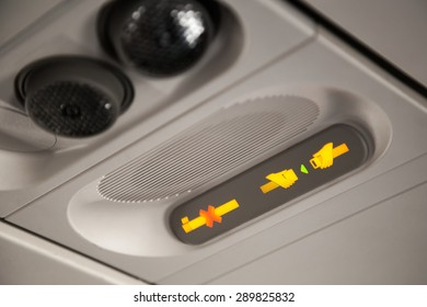 No Smoking and Fasten Seat belt Sign Inside an Airplane