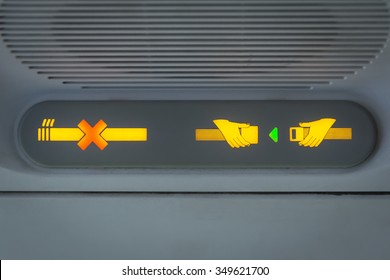 No Smoking and Fasten Seat belt Sign in the airplane