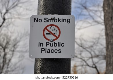 No smoking in public places posted in metal pole