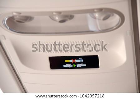 No Smoking Seat Belt Signon Airplane Stock Photo (Edit Now