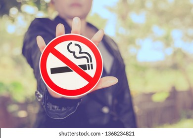 No smoking sign in hand on color background ,health concept.