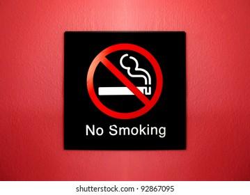no smoking sign on red grunge wall