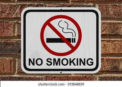 No Smoking Sign, An red and white sign with cigarette icon and not symbol with text No Smoking on a brick wall