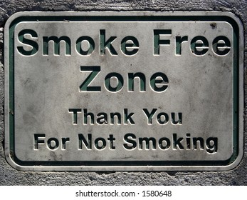 No smoking sign set in concrete