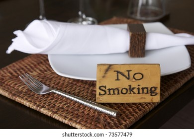 no smoking warning on dining table in restaurant or cafe