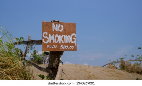 No smoking warning sign on a dry arid grass land. Fire hazard concept.Climate chage concept.