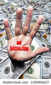 No Socialism hand coming out of pile of hundred dollar bills.