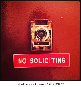 """No Soliciting"" apartment door sign in New York City with Instagram effect filter."