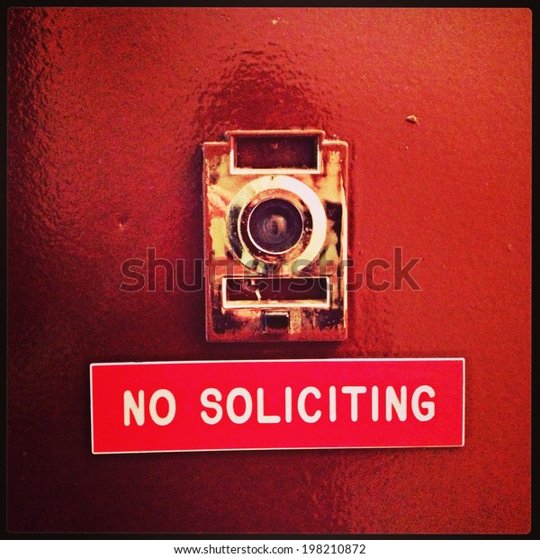 """""""No Soliciting"""" apartment door sign in New York City with Instagram effect filter."""