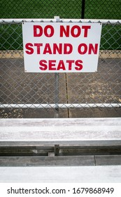 No standing sign by the bleachers